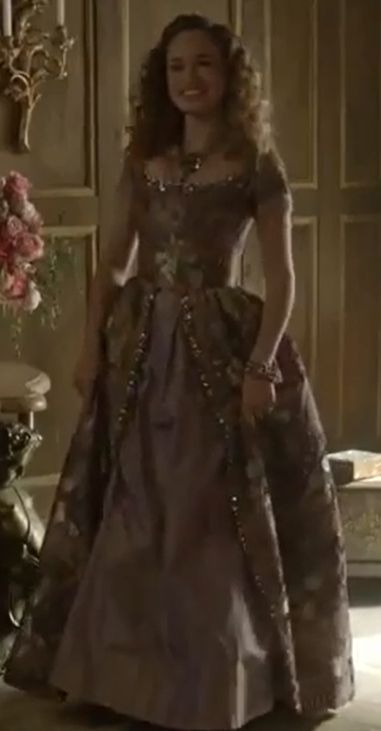 Claude in purple and gold dress.