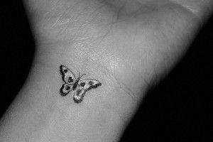 tiny monarch butterfly tattoo on wrist