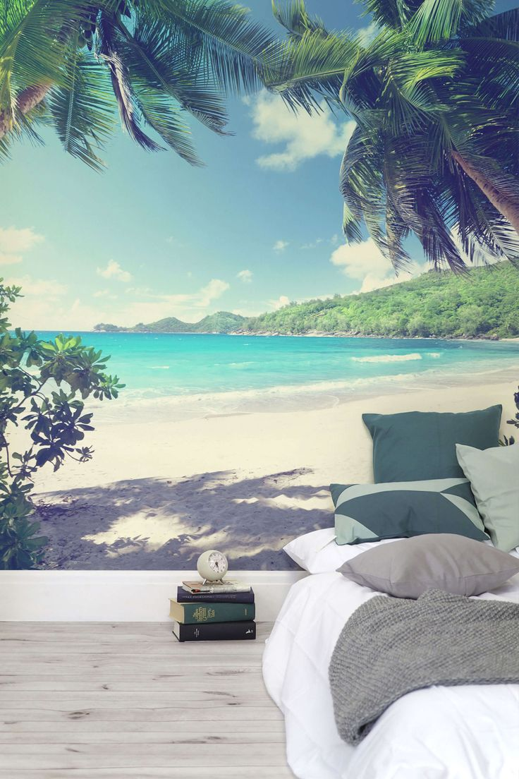 Bring sunshine vibes into your home all year around with this beautiful beach mural. Taking you right onto the beach, you can hear the gentle lapping waves with the palm trees swaying in the background. This wallpaper design is the perfect alternative to any headboard. muralswallpaper.com