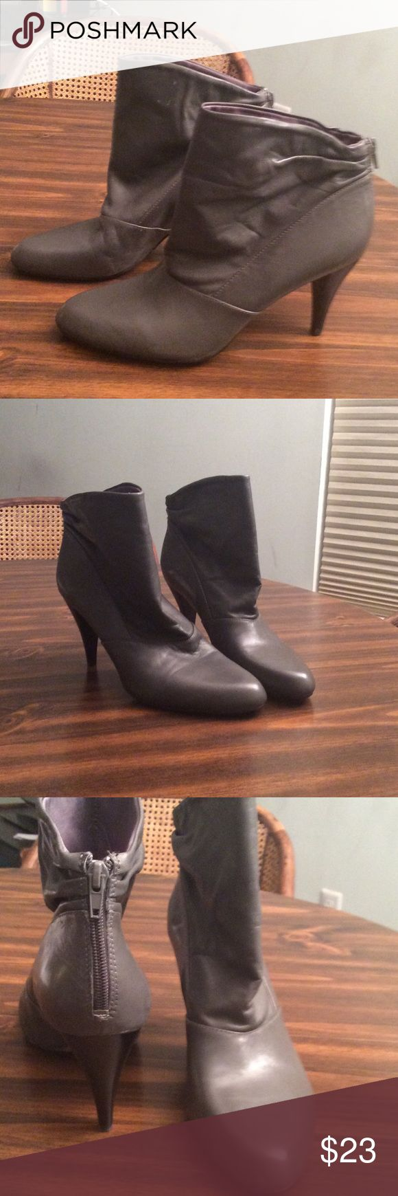 Nine West grey leather boots size 8. 1/2 Great Preowned condition. 3 inch heel, with a back zipper. Leather upper size 8. 1/2 Nine West Shoes Ankle Boots & Booties