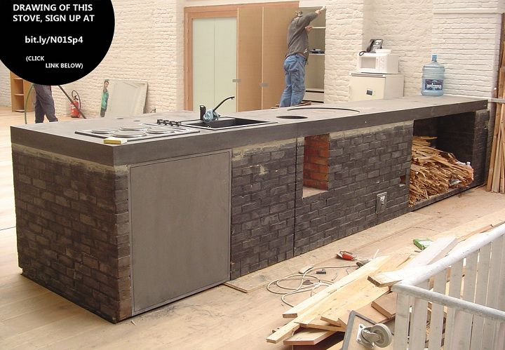 Rocket mass heater and cooktop in Brussels. Wood goes into feed to right of the sink. Cooktop is to right of the feed.