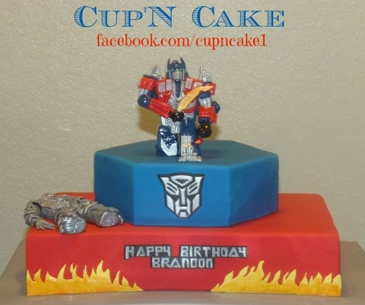 Transformers cake with hand made edible Optimus prime and ...