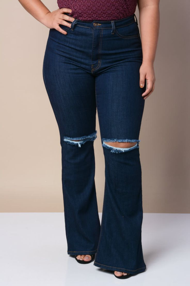 Featuring a high waisted fit, flared high-low bell bottoms with a fringed hem, two front and back workable pockets, and button-up and zipper fly closure.