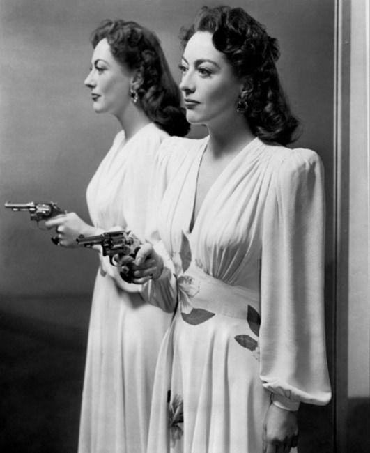 "Joan Crawford has a gun in ""Mildred Pierce,"" 1945."
