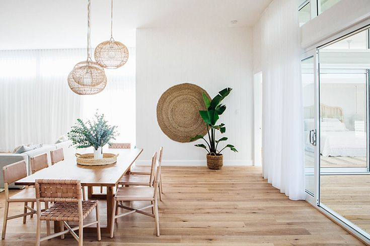 The combination of soft wood and white, with nice pops of green, bring this dining room to life