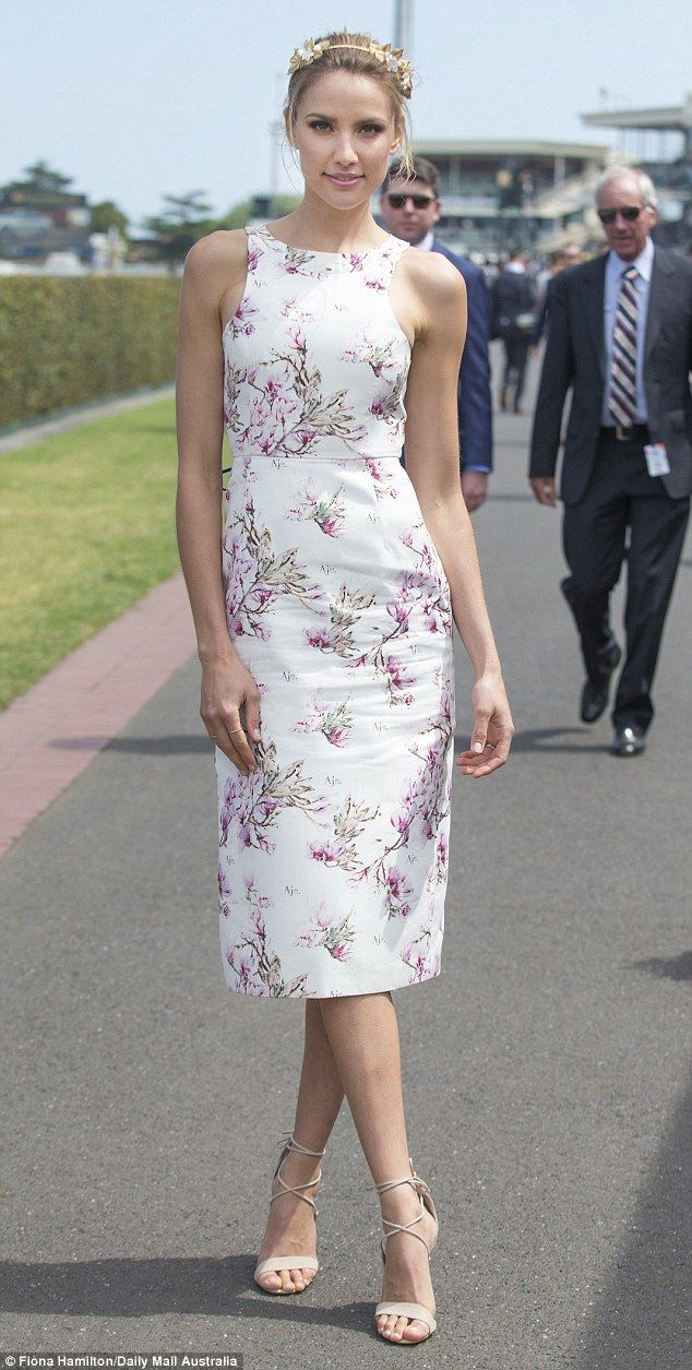 The former Miss Universe Australia was summery in a floral patterned dress and also wore n...