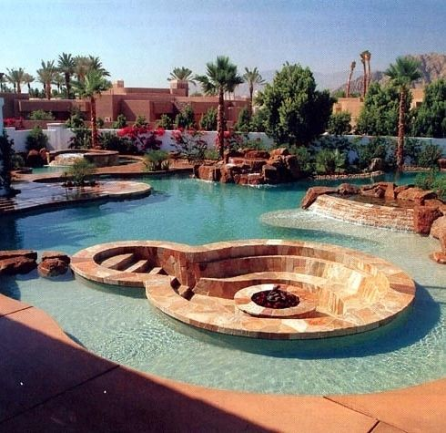 A fire pit IN A POOL!  WHOA!  (36 Things You Obviously Need…