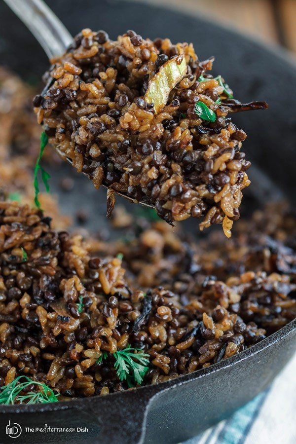 Mujadara Recipe | The Mediterranean Dish. This simple lentils and rice recipe garnished with crispy onions is a signature Middle Eastern Dish that makes for a healthy flavor-packed feast. Vegan, Gluten Free. Check out the easy step-by-step photo instructions at The Mediterranean Dish