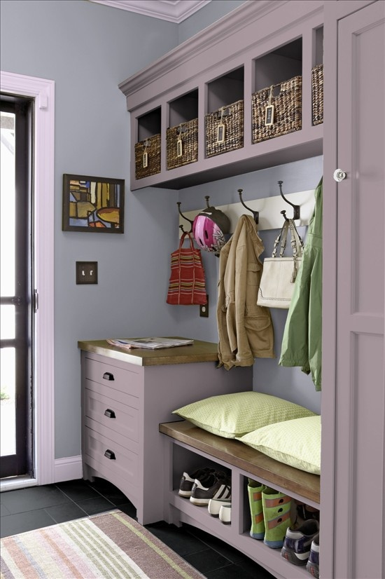 Idea for my laundry room cabinets. Add another row of cubbies and the same trim below?