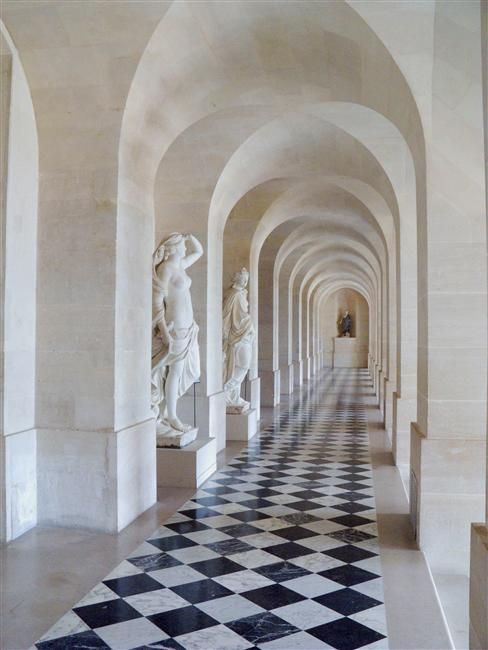 classic details...white arches all the way down the hall.