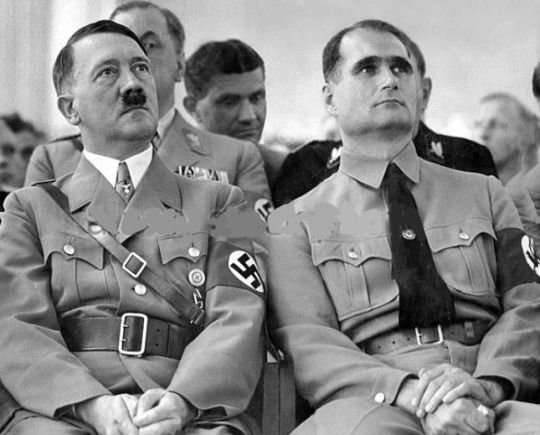 Hot Hitler!! 1934 sitting next to Rudolf Hess. Behind them are Brueckner, Fritz Wiedemann and an obscured Julius Schaub.