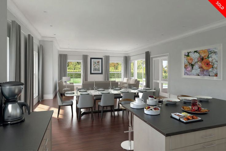 Banburg House interior.  Open plan kitchen and dining room. Large windows creating lots of natural lighting in the room. The perfect combination of modern and classic design.