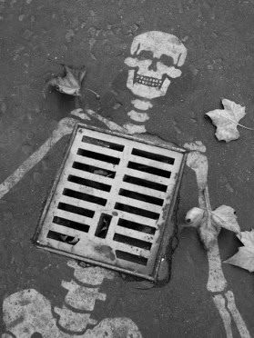 Halloween 2013 Street Art Special - Drain Skeleton.. Id use rain paint for this