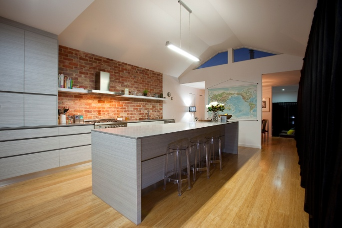 Raked ceiling Kitchen with northern facing highlight windows. Feature old red brick splashback. Embelton strand woven bamboo floors.