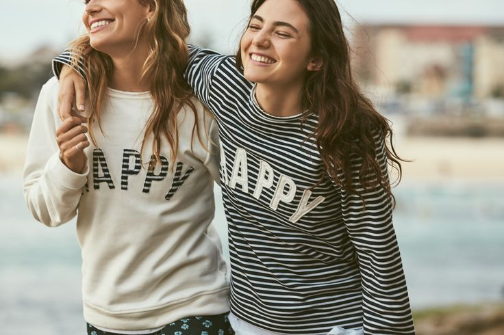 Nathalie Darcas wears Cream Happy Sweater. Amelia Zadro wears Stripe Happy Sweater.