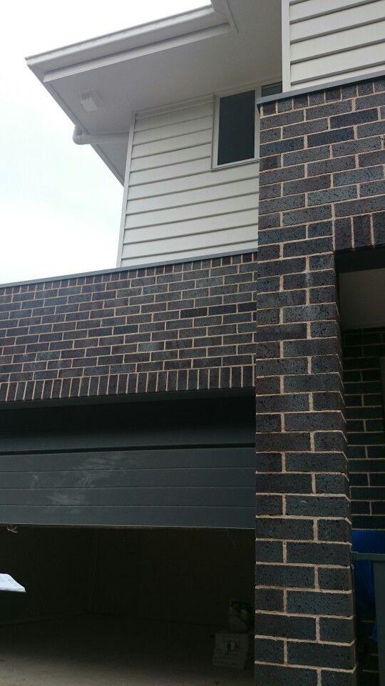 Surfmist gutter, fascia and weatherboard,  blue flash steel bricks, basalt garage door and balustrade