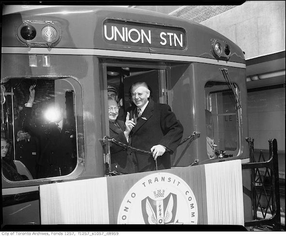 Mayor Allan A. Lamport and Ontario Premier Leslie Frost take the inaugural trip on the Yonge subway in Toronto.