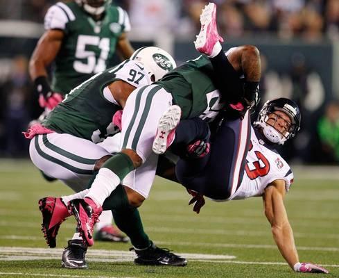 New York Jets defensive back Ellis Lankster (26) tackles Houston Texans wide receiver Kevin Walter (83)