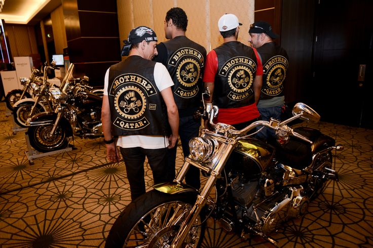 Motorbike enthusiasts with a customized Harley Davidson by CustomShop