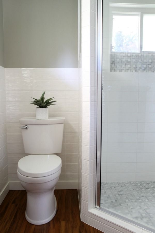 A bathroom with an identical layout to our small one. Reminder to self: It can still look good! // via House Tweaking