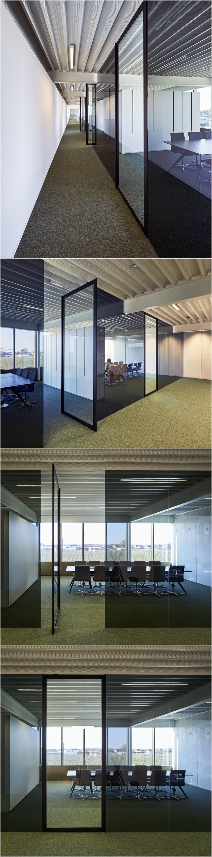 Glass office partitions in Dark Grey glass with glass pivot doors as entry doors to the various offices and meeting rooms. Portapivot's 6530 system is installed in the finished opening, without any built-in parts to either floor or ceiling.