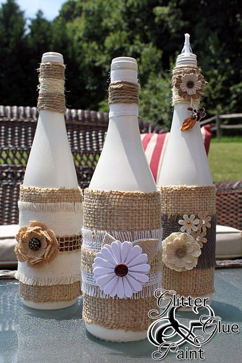 Tiki Wine Bottles - Glitter Glue & Paint - Let the bottles dry for a couple days. Then it's time to decorate. Use a variety of burlap, burlap ribbon, twine and embellishments. Split the bottles up in groups of three and coordinated the colors and start decorating.