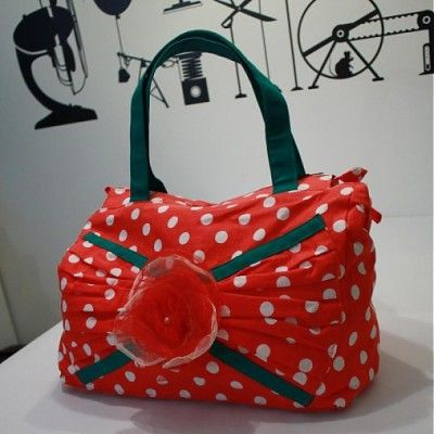 Lovely summer bag made of polka dot cotton fabric.