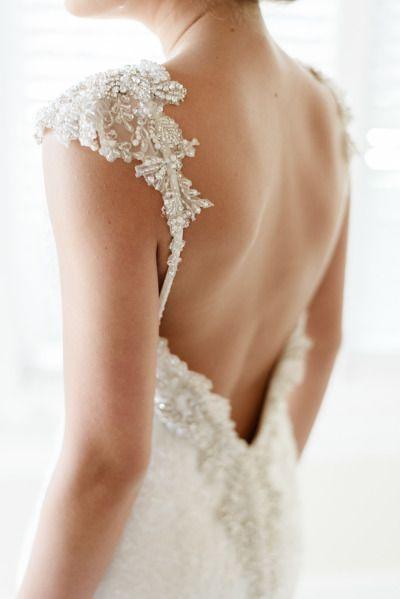 Beaded low back: http://www.stylemepretty.com/2015/07/13/25-stunning-backless-wedding-dresses/