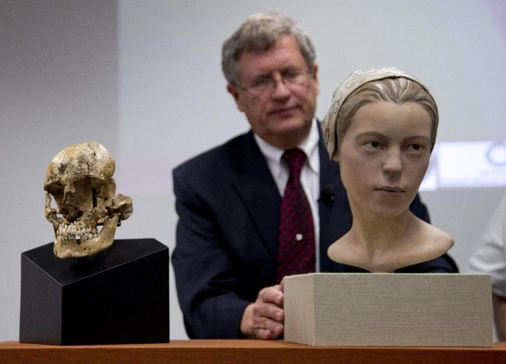"Doug Owsley, division head for Physical Anthropology at the Smithsonian's National Museum of Natural History, displays the skull and facial reconstruction of ""Jane of Jamestown"" during a news conference. They have found the first solid archaeological evidence that some of the earliest American colonists at Jamestown, Va., survived harsh conditions by turning to cannibalism presenting the discovery of the bones of a 14-year-old girl, ""Jane"" that show clear signs that she was cannibalized..."