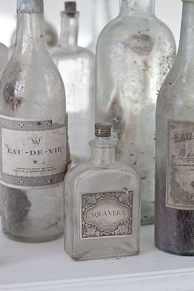 I want a bunch of old bottles with gorgeous labels.  image via Angel at my Table blog.
