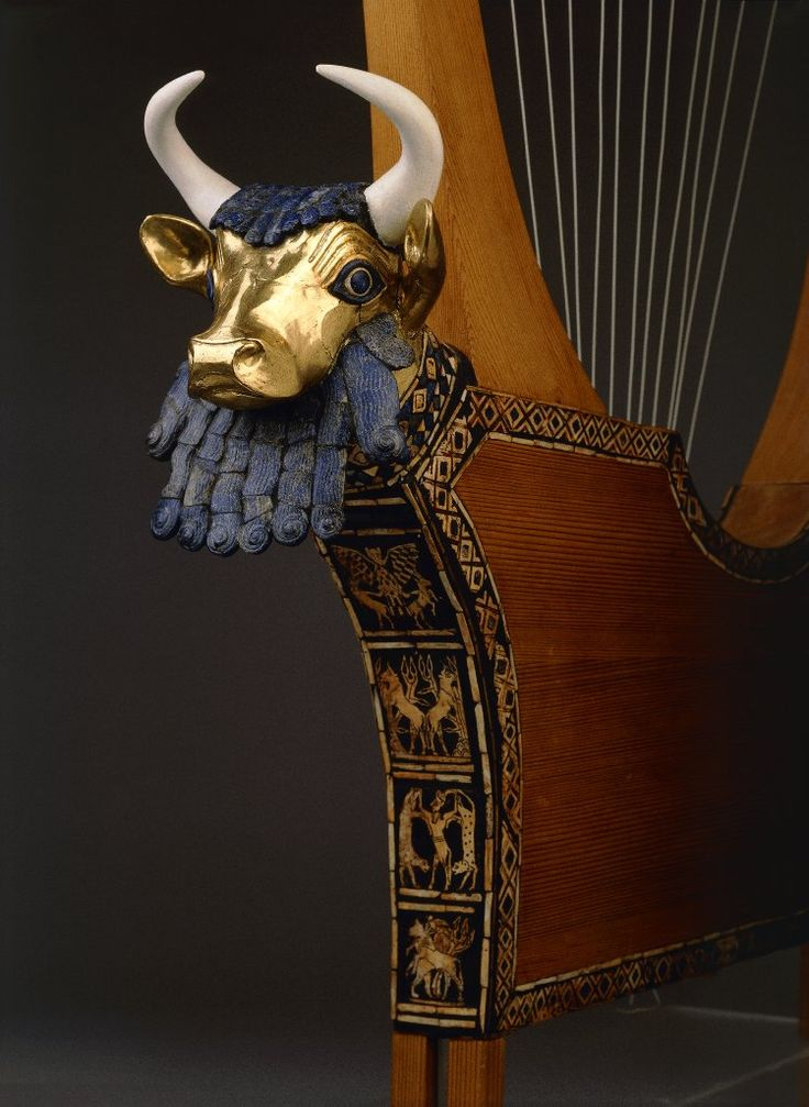 Queen's Lyre; reconstruction; wooden parts, pegs and string are modern; lapis lazuli, shell and red limestone mosaic decoration, set in bitumen and the head (but not the horns) of the bull are ancient; the bull's head in front of the sound box is covered with gold; the eyes are lapis lazuli and shell and the hair and beard are lapis lazuli; the significance of the beard is not known; panel on front depicts lion-headed eagle between gazelles, bulls with plants on hills, a bull-man between…