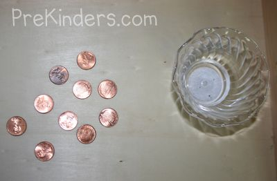 """Coin Cleaning    Children bring in """"dirty"""" pennies from home and experiment with various ingredients: vinegar, salt, and ketchup, along with some ingredients that will not clean pennies well (such as water, flour, etc.) Children experiment with the different materials to find what cleans pennies the best. (Vinegar and salt together will clean pennies, and ketchup by itself will clean them.)"""