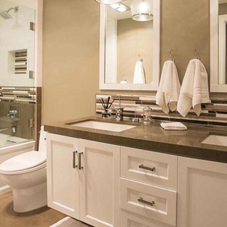 This elegant bathroom features a crisp white double vanity for Brown paint for bathroom
