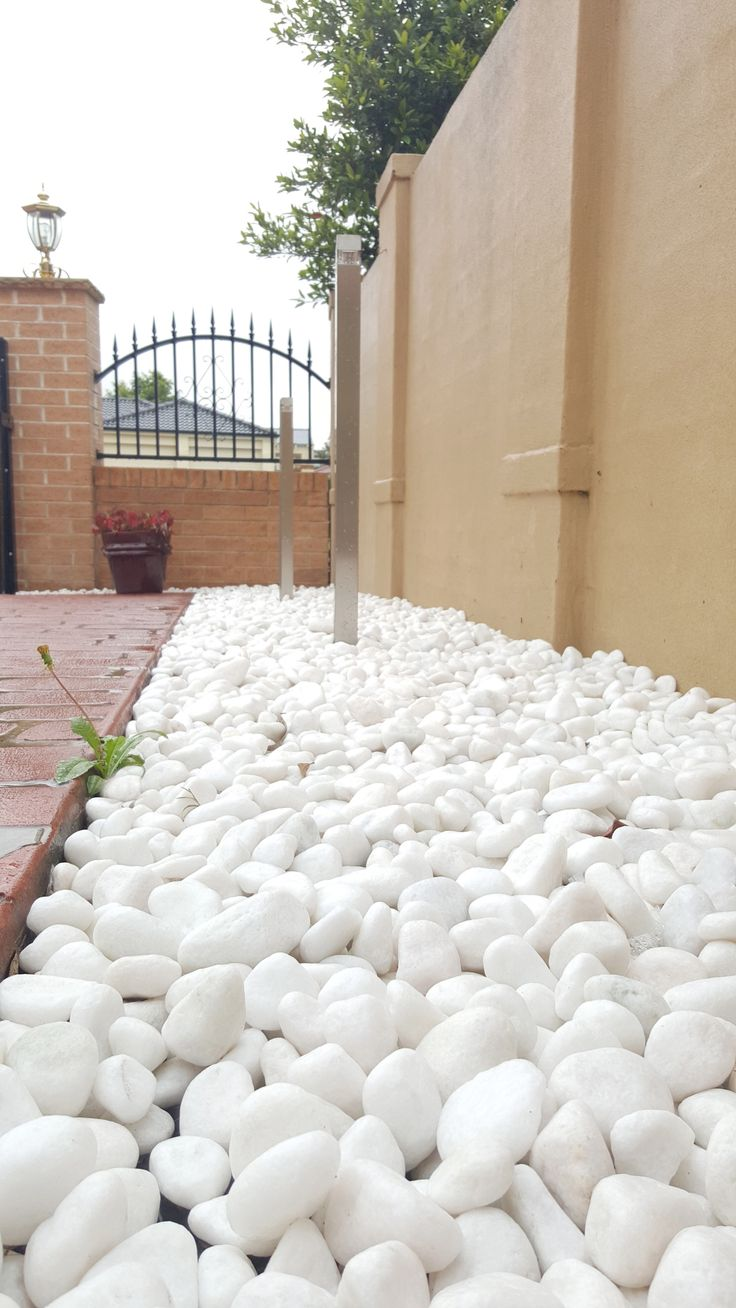 White Quartz Stone Pebbles. Visit our website for more ideas on how to improve your home #pebbles #stonepebbles #gardenpebbles