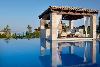 The Romanos, Costa Navarino. Immerse yourself in the historical richness of this seaside resort near Pylos, Greece, where hospitality and thoughtful amenities reign.