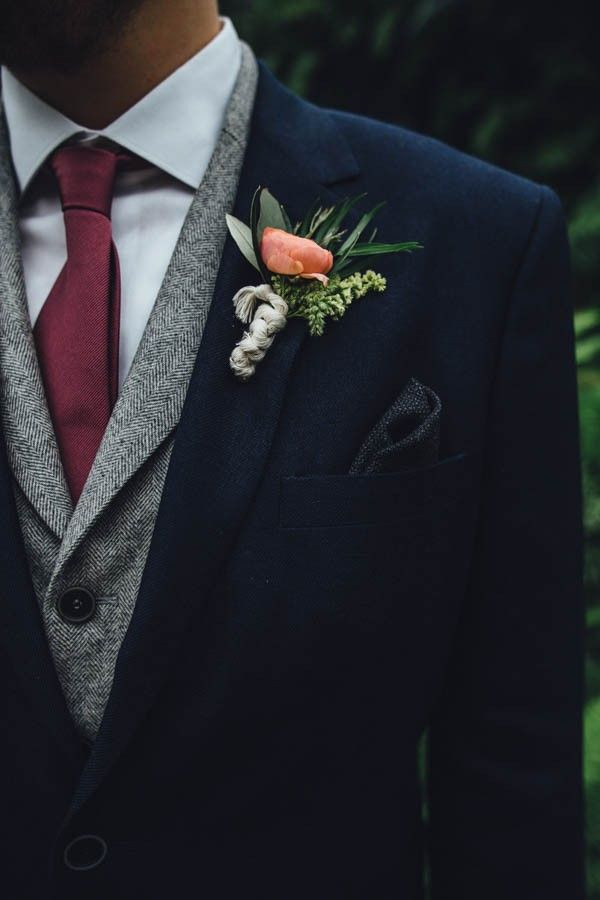 Coral bridal boutonniere | Industrial Garden Wedding Inspiration at Garfield Park Conservatory via @junebugweddings, pics by Erika Mattingly