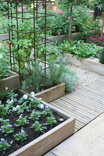 Great garden boxes--like how they are different heights. What a beautiful garden.
