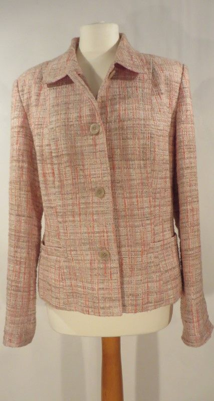 Vintage boucle rose coloured jacket, 14.   Pretty rose coloured wool mix boucle jacket. Full lined with pearlised pinky-brown buttons.   Size: 14 Measurements: B: 42, W: 38, H: 44, L: 22, S-S: 17 Label: None Decade: 1970 Material: Wool / cotton blend Cleaning instructions: Dry clean