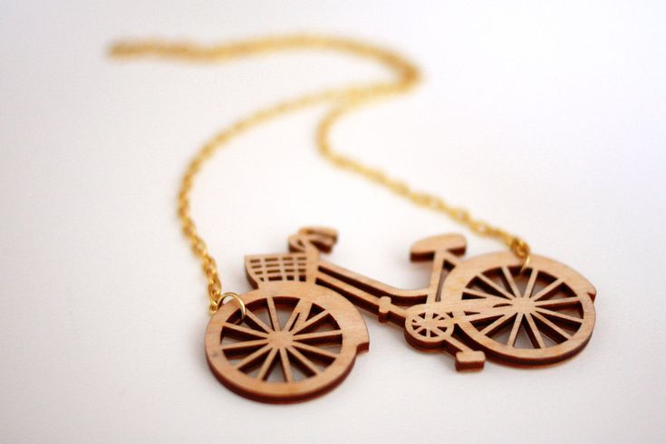Wooden Bicycle Necklace, Laser cut in Birch wood on gold plate chain.
