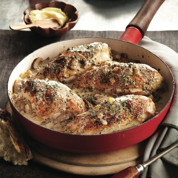 Traditional coq au vin uses red wine, which can result in a slightly purple finished dish. This white version is considerably more elegant.