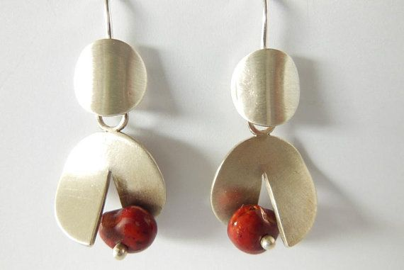 These stylish Earrings are the Primes plus a set of Enhancers. They are hand crafted using Sterling Silver and Natural seeds.  The Svelte Studio Dawn Collection consists of a pair of elegant earrings, the Primes, and a range of stylish, interchangeable Enhancers. The Primes, although
