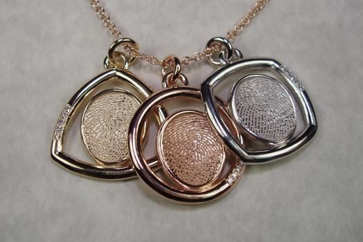 Custom fingerprint charms/pendants made from the actual fingerprint of your loved one. Awesome gift idea.  Roemer Originals