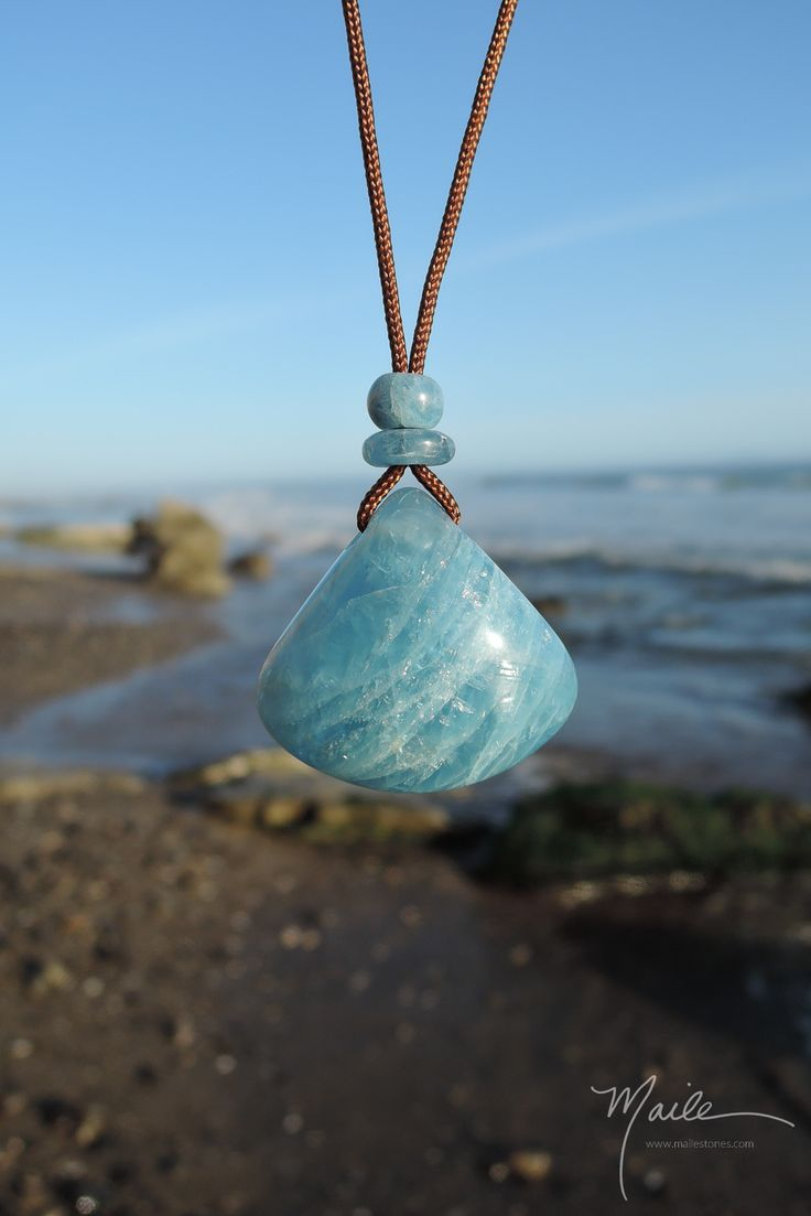 One of a kind Aquamarine from Angola, hand carved into a pendant with Aquamarine accent beads and strung on brown cord with adjustable sliding bead and two bead dangles. Length range up to approximate