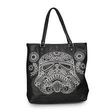 The Star Wars Storm Trooper Walking Stitch Floral Denim Tote is a faux leather tote bag that has a storm trooper and flowers embroidered across the front of the bag. This unique design showcases both your love of the Empire and its loyal elite soldiers.