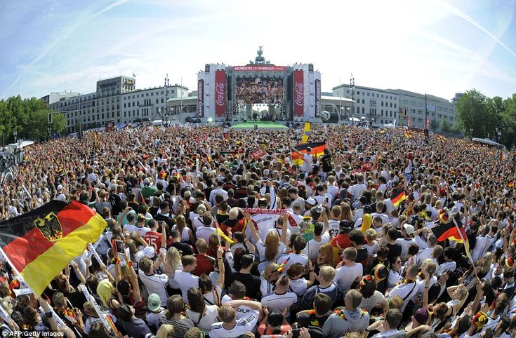 Ready and waiting: Germany's supporters await the arrival of the country's World Cup stars...