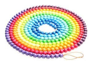 "Each  day, one wooden bead gets added.  Each month is associated with a different color, and children can ""grasp"" what makes a day, a month, or even a year. The annual beads string consists of 372 wooden beads in a rainbow of 12 colors, an eight meter cord, and cotton bag for storage. Made in Germany."