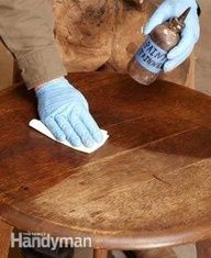 Wipe on mineral spirits. clean with ivory dish soap. Use gel stain. no need to strip the wood.