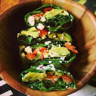 Kale Guacamole Wraps = 2 medium kales leaves + 1/2 avocado + tomato + onion + feta cheese + lime + salt/pepper