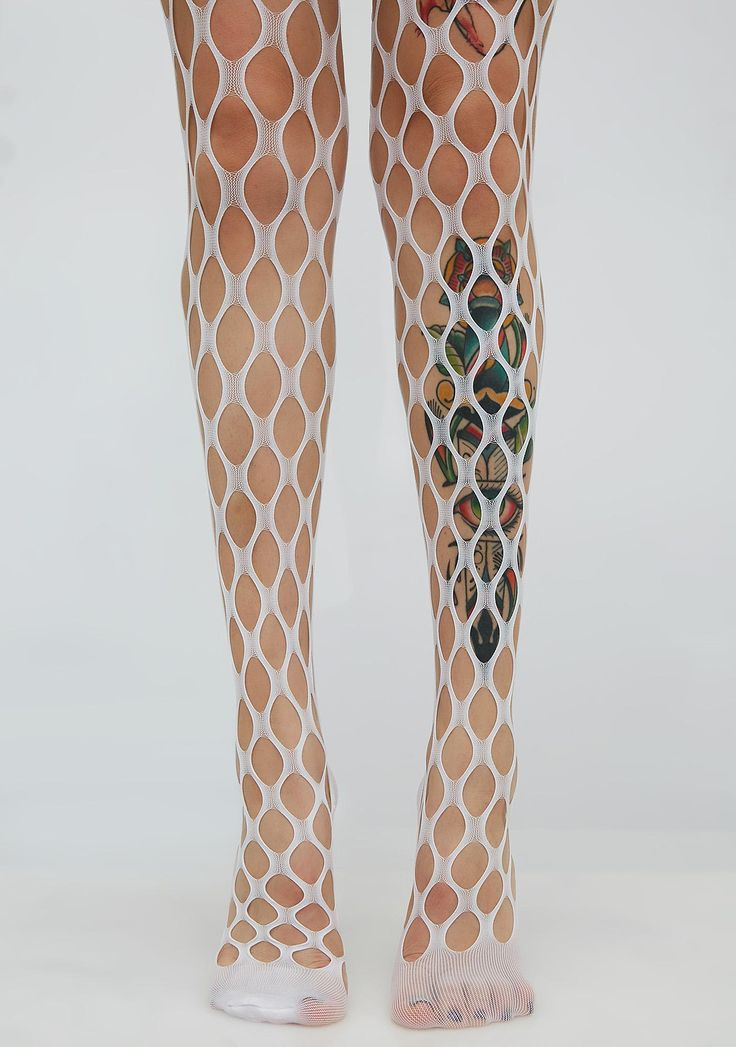 In My Web Sheer Tights and you're not lettin' go. These white tights have a large fishnet design that will give your look some sass.