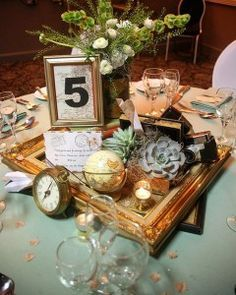 Travel centerpieces- love that idea with the frames.